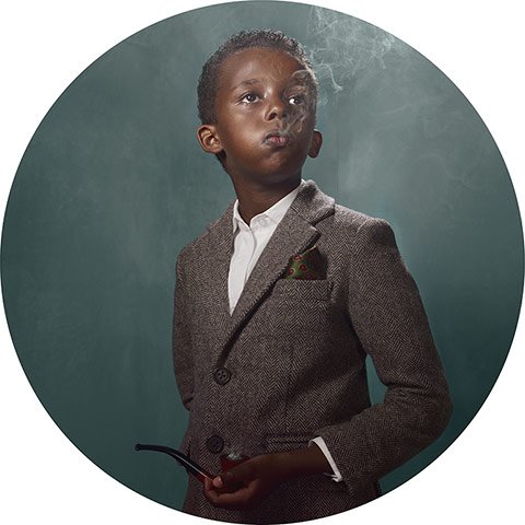 young black boy in a jacket smoking