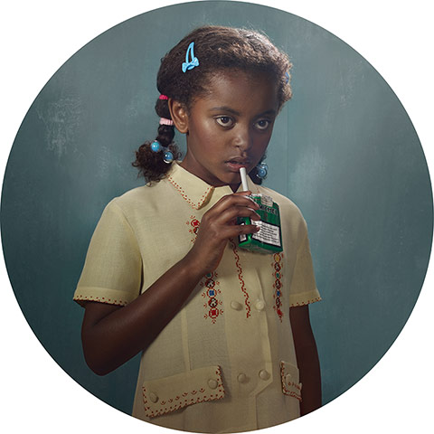 young black girl about to smoke a cigarette