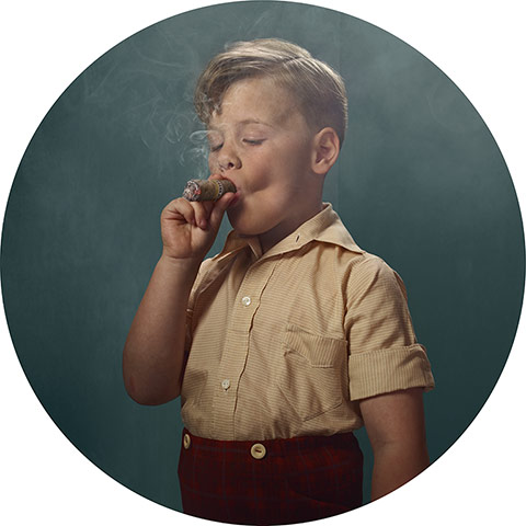 young boy with blond hair smoking